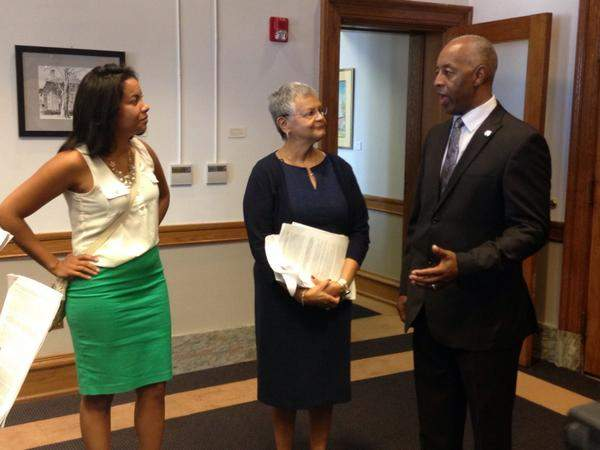 New Jersey Working Families executive director Analilia Mejia (far left) and Assemblywoman Bonnie Watson Coleman (D-Trenton) delivered petitions Tuesday to Trenton mayor Eric Jackson.