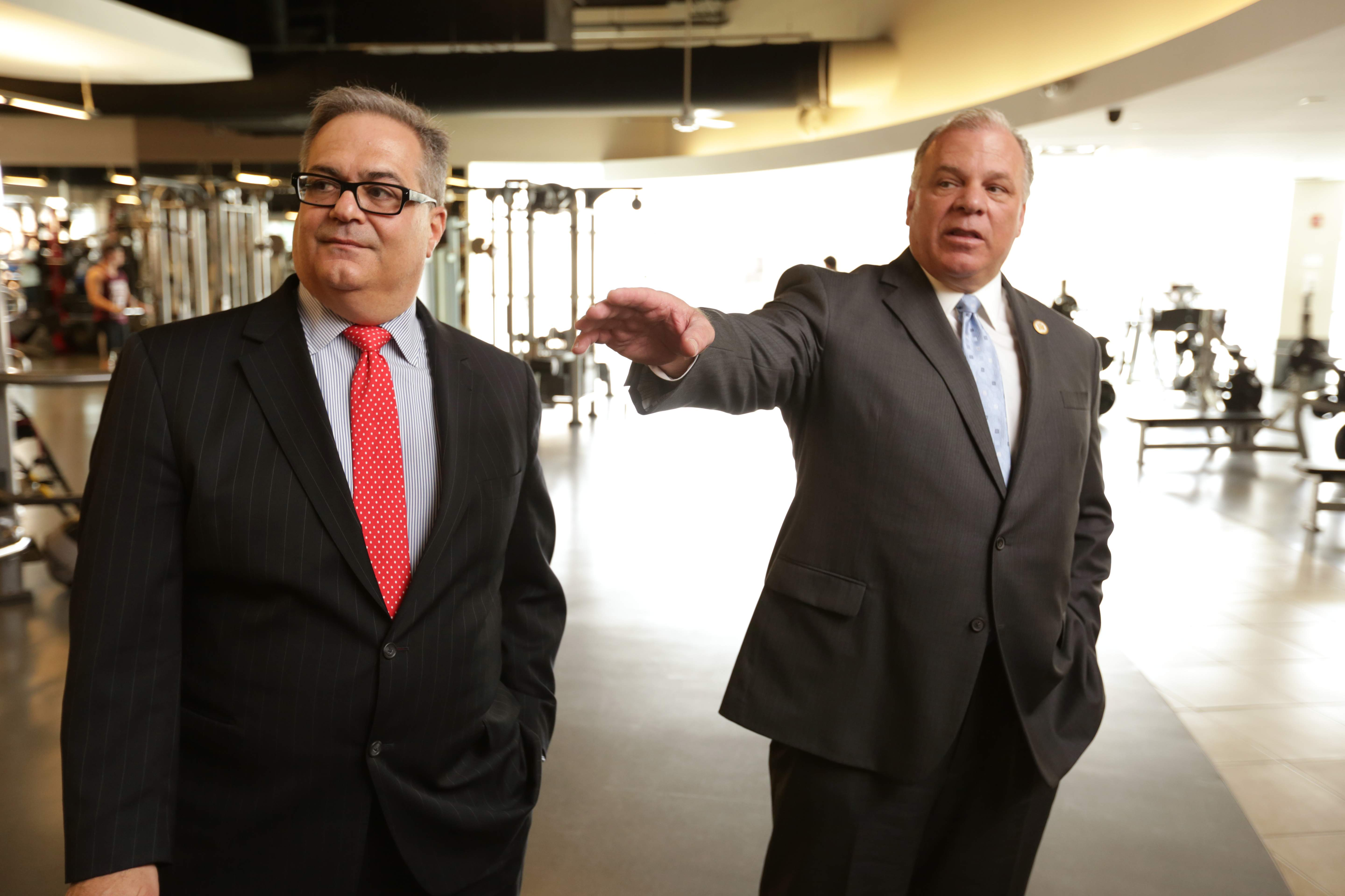 From left, Chris Paladino takes Senate President Steve Sweeney Steve Sweeney on a tour of DEVCO's projects in New Brunswick.  The two are pictured in the Wellness Plaza fitness center.