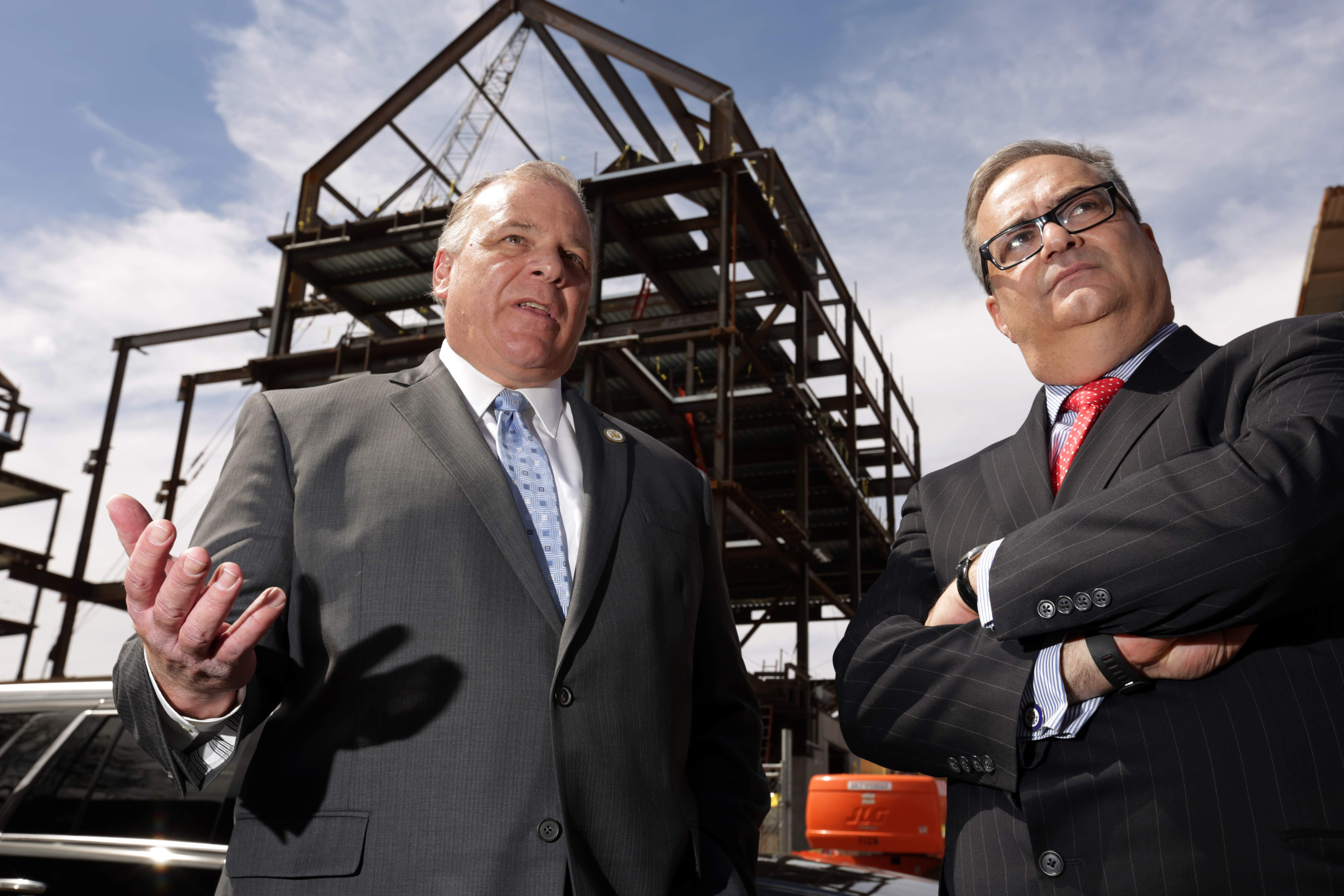 Standing in front of Rutgers' new Academic Building, left, and Honors College, Senate President Steve Sweeney, left, and Chris Paladino speak to the press.