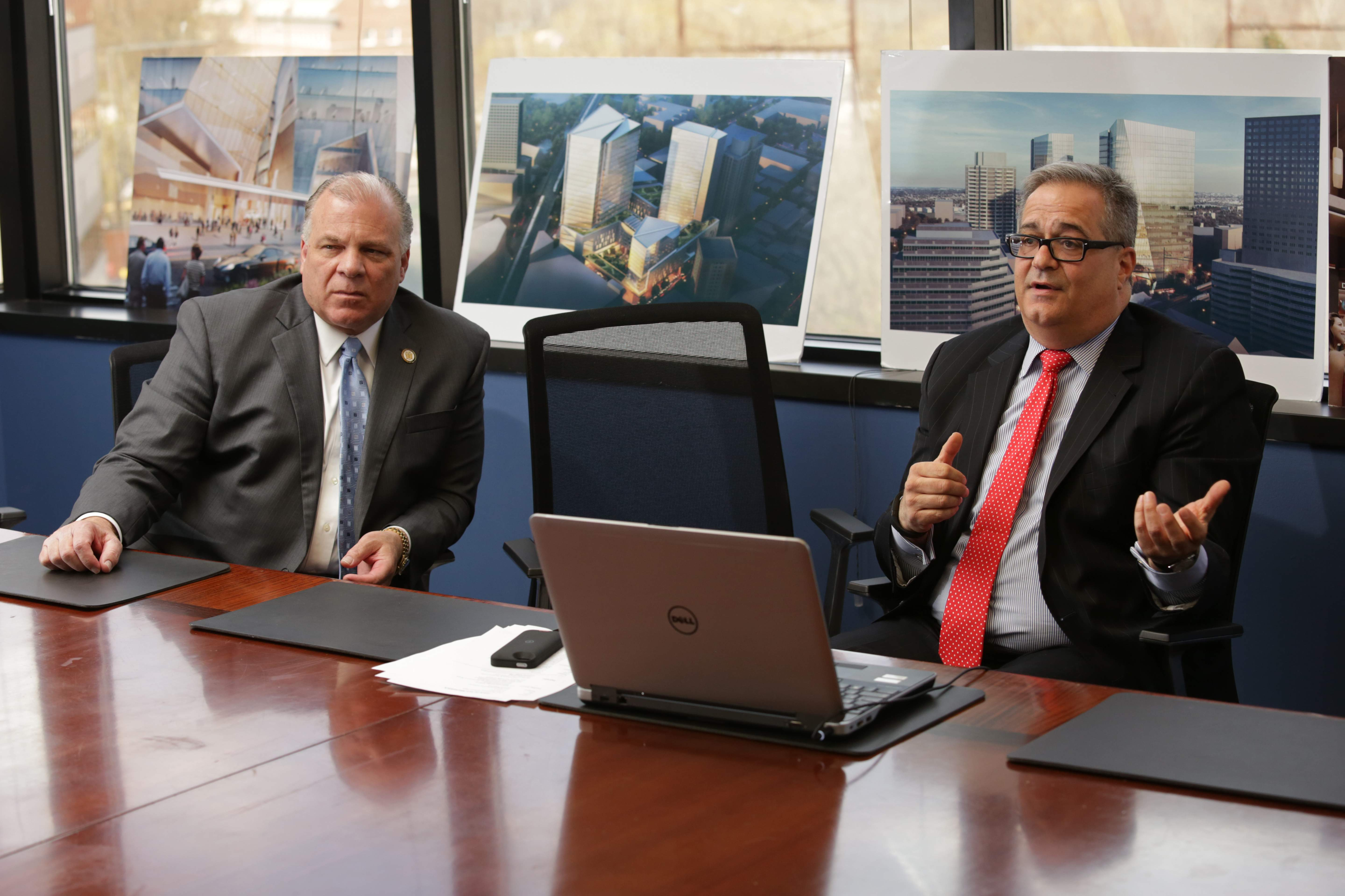 Chris Paladino, right, makes a presentation before taking Senate President Steve Sweeney on a tour of DEVCO's projects in New Brunswick.