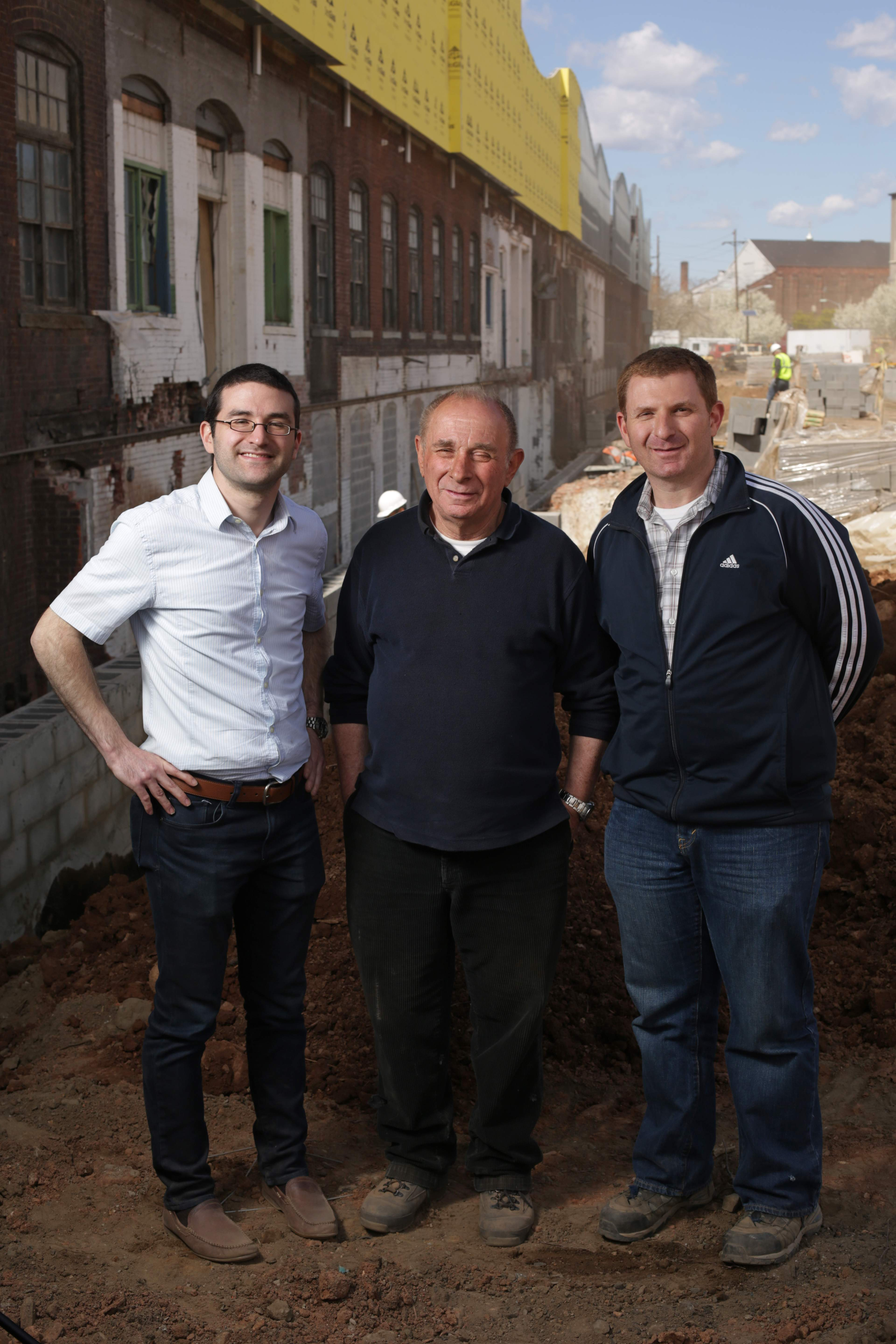 Shimon Einhorn and his sons, David, left, and Shamir, co-directors of Contempo Space in Passaic. The three are pictured in front of the future Contempo Plaza.