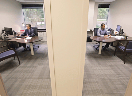 Anthony Sylvester, left, founding partner, and Arjun Shah, associate, work in offices of the same size at Sherman Wells Sylvester & Stamelman LLP.