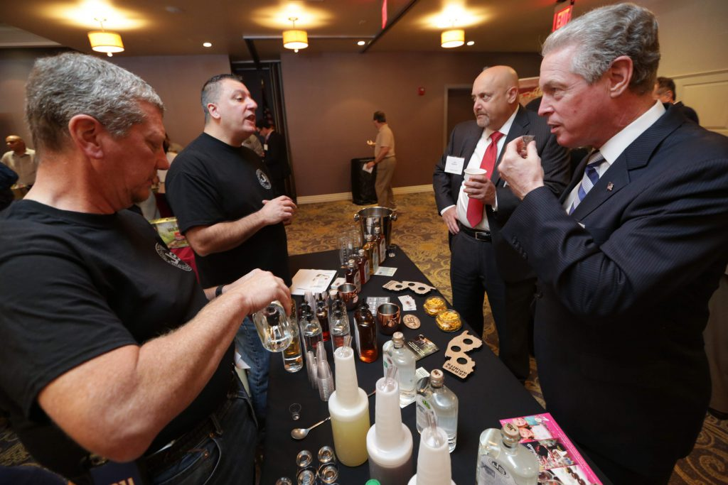 Attendees try samples at the Jersey Spirits booth at NJBIZ's Food Day event. Jersey Spirits Distilling Co. is an award-winning craft distillery located in Fairfield. They hand-craft all of their spirits, including vodka, whiskey, rum, gin and bourbon.