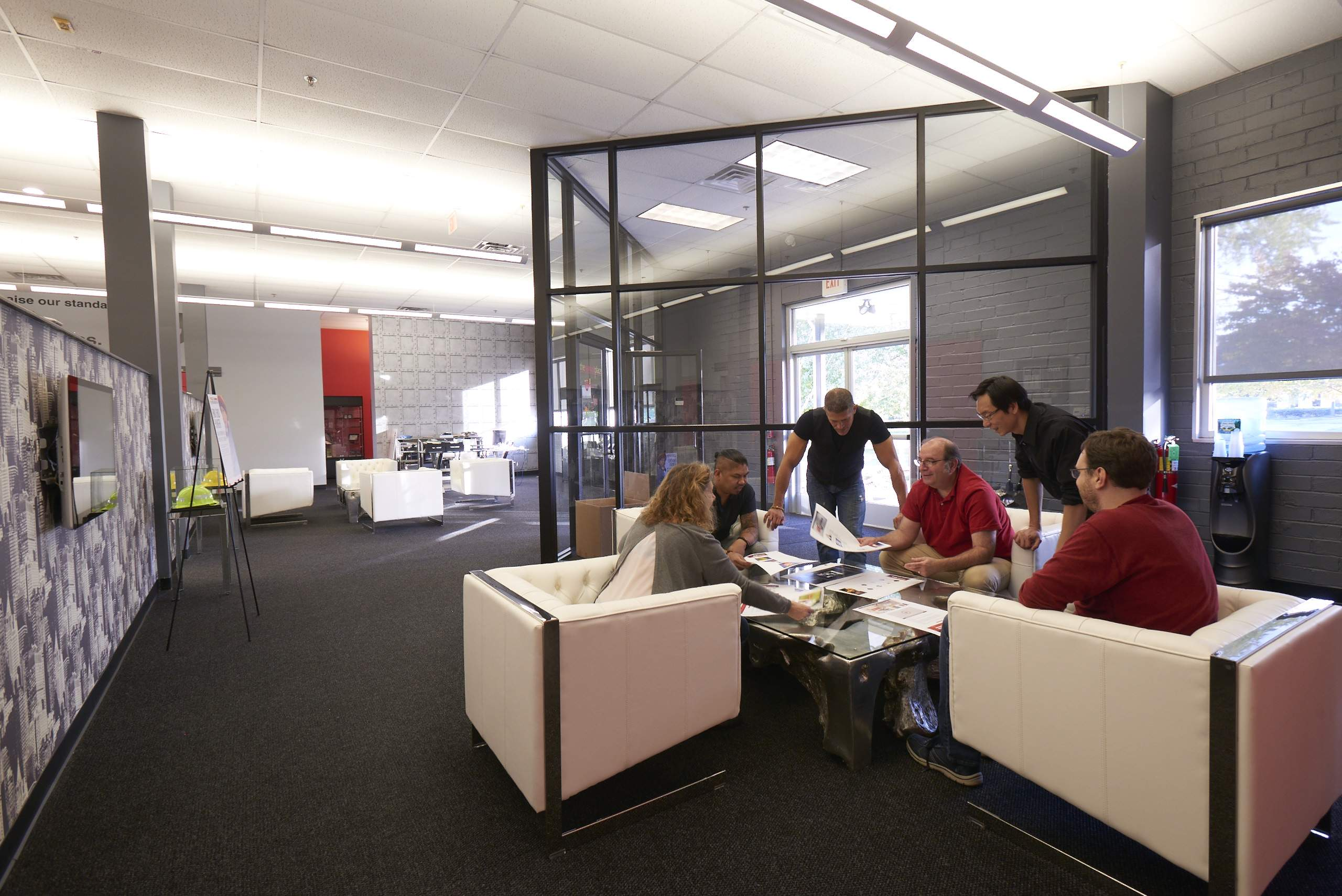 """Employees collaborate in new """"pods"""" created for Marketsmith's renovated Cedar Knolls base."""