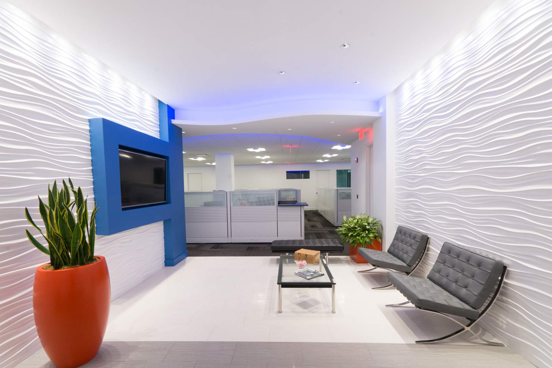 Prism Capital Partners has taken occupancy of a new 7,000-square-foot office in Bloomfield that has a modern workplace aesthetic with curved angles and color-changing illumination throughout.