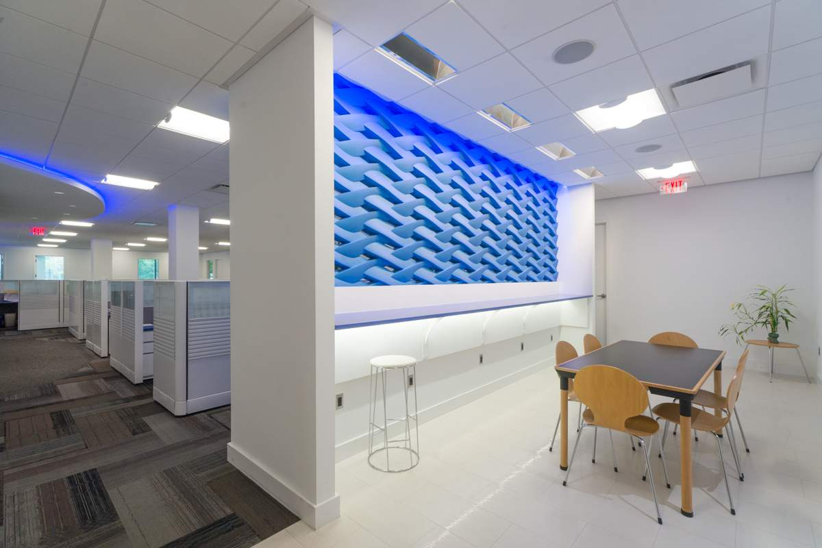 The Aztec Corp., the firm that designed the space, implemented many contemporary elements in the space at 200 Broadacres Drive.