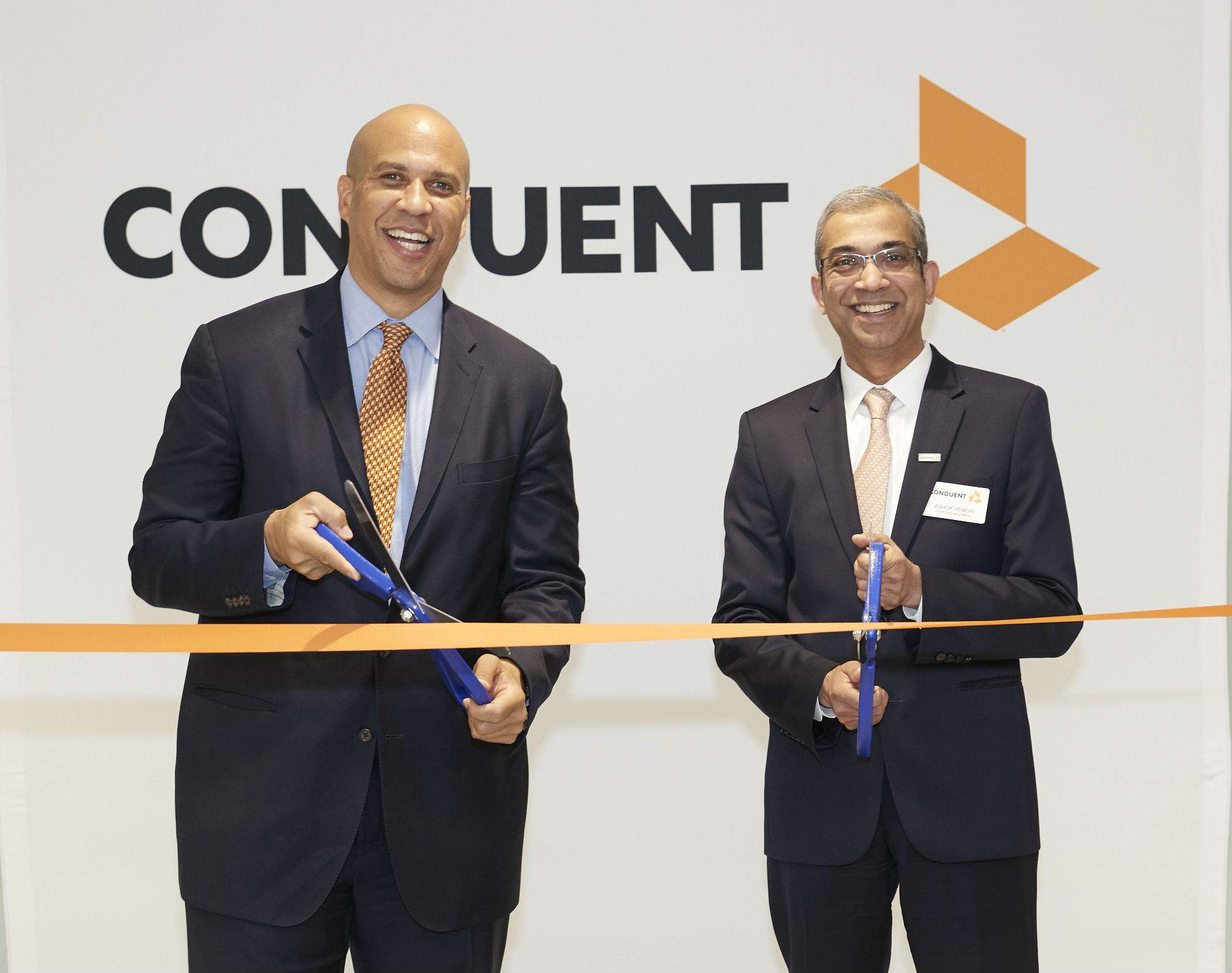 U.S. Sen. Cory Booker and Conduent CEO Ashok Vemuri cut the ribbon on Conduent's headquarters in Florham Park on June 2, 2017.