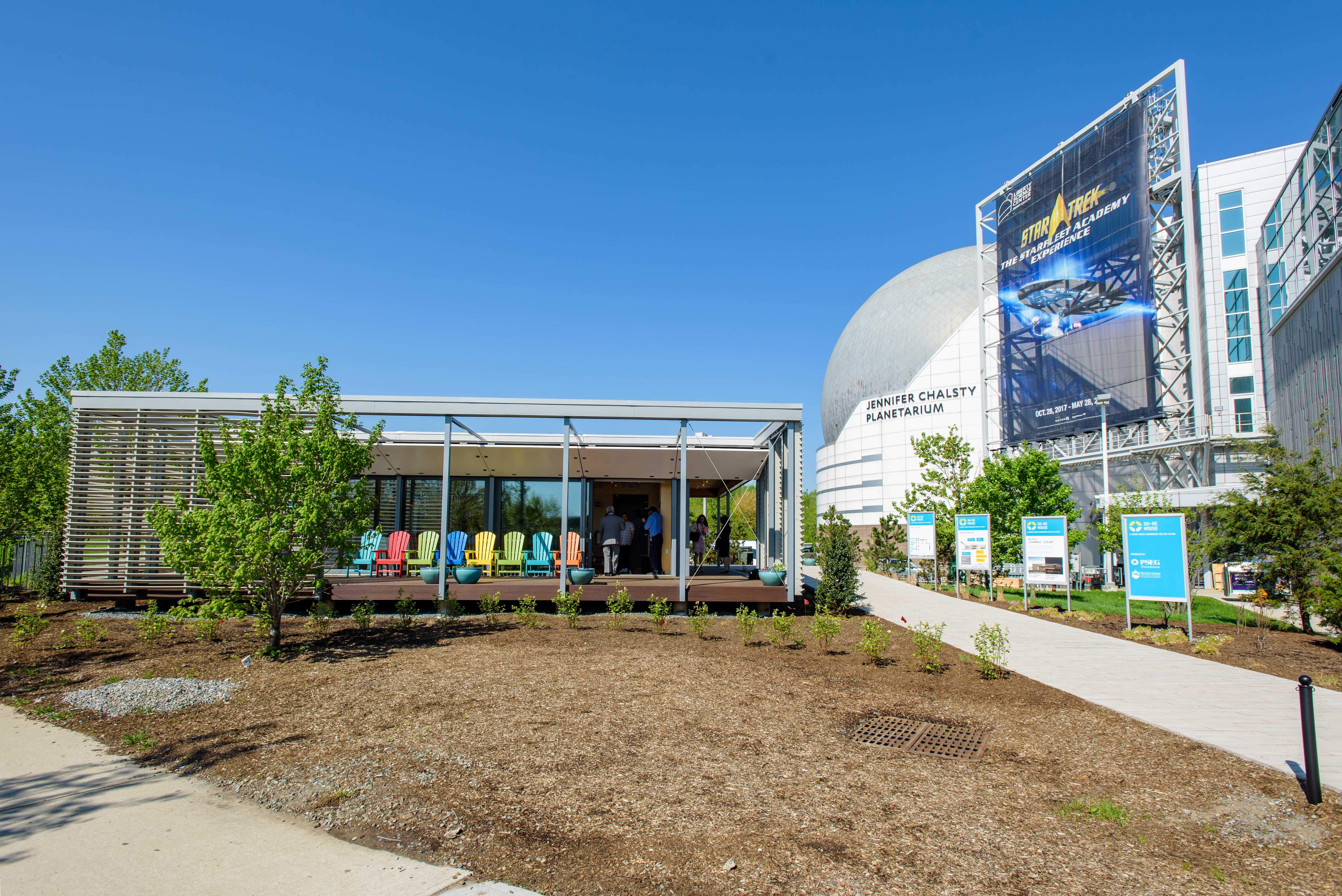 The SU+RE House is now a permanent exhibition the Liberty Science Center with tours available throughout the day.