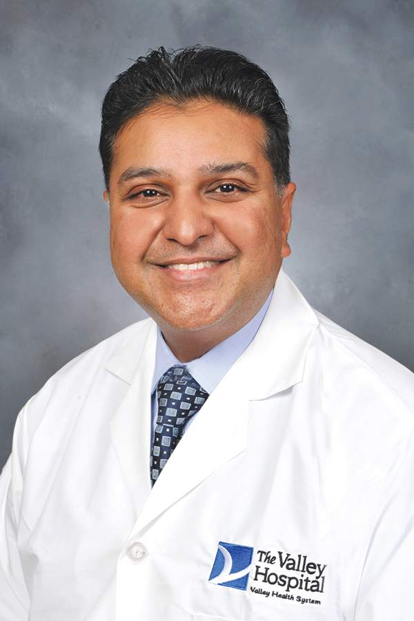 Valley Hospital<br/><br/><br /> Telemedicine is quickly becoming a staple among providers in the growing movement toward patient-centered care.<br/><br/><br /> This past year, Dr. Suneet Mittal, head of the Snyder Center for Comprehensive Atrial Fibrillation at Valley Hospital, helped take the concept of telemedicine one step further. In 2017, he helped implement virtual office visits for hospital patients suffering irregular heartbeats and those at risk for heart attacks.<br/><br/><br /> Patients now can access Valley doctors via their computer, smartphone or tablet using real-time audio and video technology provided bySnapMD, which specializes in telemedicine and is partnered with Valley.<br/><br/><br /> The service charges a flat fee of $49.99 that is not covered by health insurance but can be paid for through a patient&#8217;s flexible spending account.<br/><br/><br /> &#8220;Our team believes in the total patient management approach,&#8221; Mittal said in a statement. &#8220;We work with patients to ensure they are getting the best available treatment for their atrial fibrillation, while also addressing other contributing health issues such as stress, hypertension, sleep apnea and obesity.&#8221;<br/><br/><br /> Mittal was named chair of the unit when it was created in 2016 by parent Valley Health, and has been with the system since 2006. Since then, he has helped turn the unit into one of the premiere heart specialty units. Last year, it was nationally ranked by U.S. News and World Report as one of the best cardiovascular and heart surgery centers in the U.S.