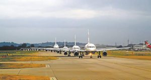 A line of planes prepares to take off at Newark Liberty International Airport.