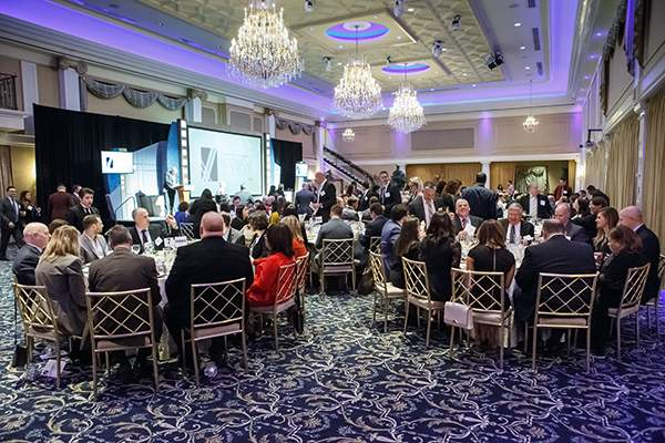 Guests enjoy a sit-down dinner at the 2018 Business of the Year Awards ceremony at The Palace at Somerset Park. - AARON HOUSTON
