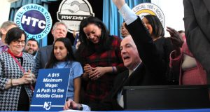 On Feb. 4, 2019, Gov. Phil Murphy signs legislation increasing the minimum wage to $15 an hour by 2024 at the Make the Road NJ headquarters in Elizabeth.