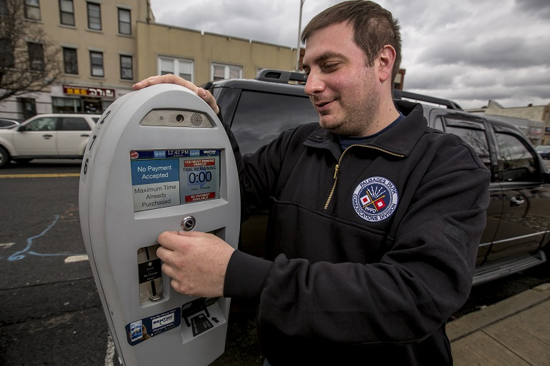 The borough of Palisades Park recently began using automated parking meters. Pictured is Palisades Park Borough Communications Manager Robert DeVito. - AARON HOUSTON