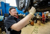 Ed Farnish installs a control arm on a customer vehicle at Malouf Chevrolet Cadillac in North Brunswick. Farnish is receiving training through NJ CAR's Automotive Technician Apprenticeship Program.