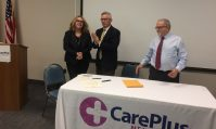 Department of Human Services Commissioner Carole Johnson, former Gov. Jim McGreevey and Joseph Masciandaro, president and CEO of CarePlusNJ, at CarePlus NJ to announce a partnership with the New Jersey Reentry Corp. on July 18, 2019.