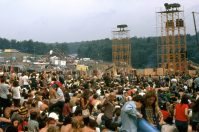 Three towers at Woodstock in 1969 The far left one is a light tower and of the two to its right, one is another light tower, the other a sound tower.