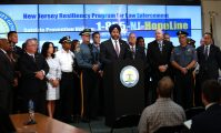 New Jersey Attorney General Gurbir Grewal announces the New Jersey Resiliency Program for Law Enforcement during a press conference with Cherie Castellano, program director Cop 2 Cop; Pat Colligan, president, New Jersey State Policemen's Benevolent Association; Jim Stewart, vice president, New Jersey State Fraternal Order of Police; Chief Christopher Leusner, president, NJ State Association of Chiefs of Police; and Burlington County Prosecutor Scott Coffina at the 911 Call Center in Newark on Aug. 6, 2019.