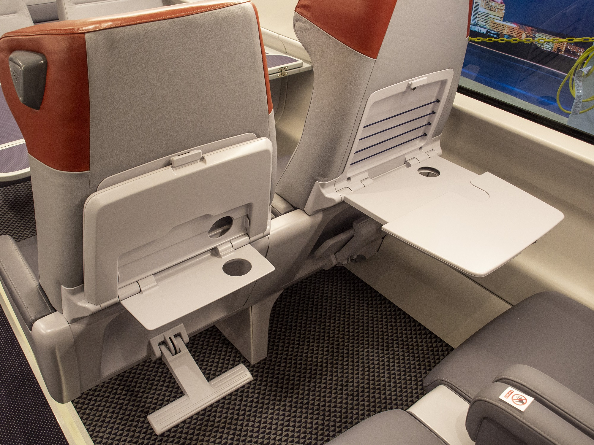 Acela's seat backs are equipped with dual tray tables providing customers with a large and small table option.