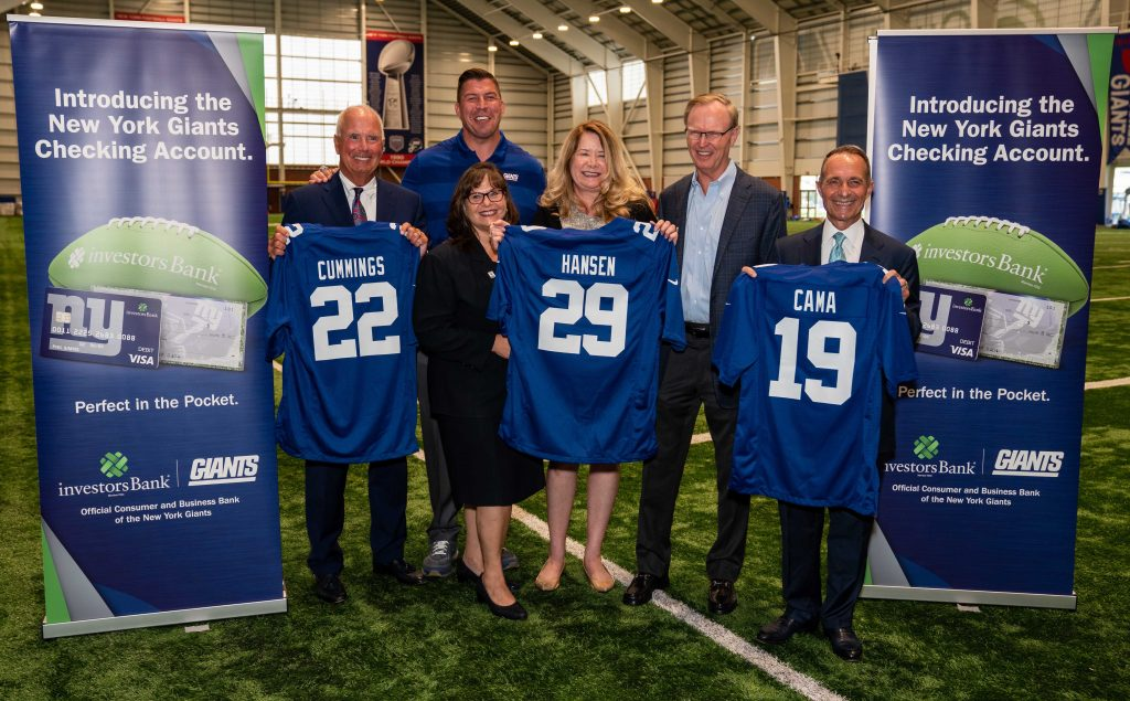 From left, Investors Bank CEO Kevin Cummings, former NY Giants offensive lineman David Diehl, CASA of NJ Associate Director Liza Kirschenbaum, Investors' Chief Marketing and Product Officer Dorian Hansen, NY Giants CEO John Mara and Investors' President and COO Domenick Cama celebrate the New York Giants Checking Account from Investors Bank and the New York Giants on Aug. 13, 2019 at the Quest Diagnostics Training Center.