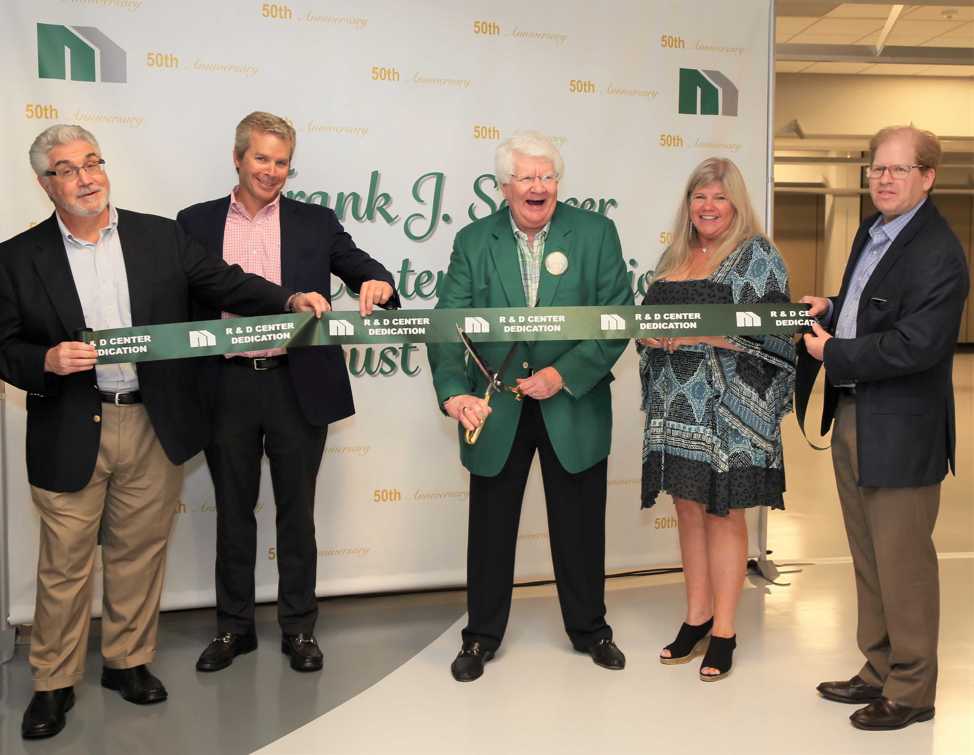 Alfred Carolonza, director of marketing research and strategy; Brian Semcer, president; Frank Semcer Sr., chairman; Paige McCann, shareholder and manufacturing coordinator; Frank Semcer Jr. director of human resources cut the ribbon at Micro's newest Somerset location.