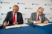From left, Dr. William Owen Jr., dean and chancellor, Ross University School of Medicine and Eugene Cornacchia, president, Saint Peter's University sign an agreement to help more Hispanics attend medical school at Saint Peter's campus on Aug. 14, 2019.