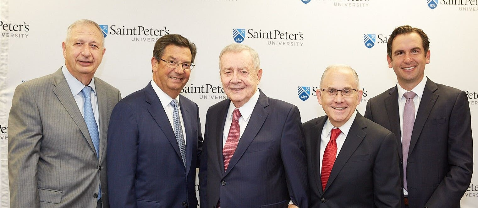 From left, Joseph Panepinto, '66, president and CEO of Jersey City-based Panepinto Properties and a member of the Saint Peter's Board of Trustees; Frank Fekete, '75, managing partner of Mandel, Fekete & Bloom CPAs; Frank Guarini, H '94; Eugene Cornacchia, P president of Saint Peter's University; and Jersey City Mayor Steven Fulop, H '14, together in September 2019 to announce the Frank J. Guarini School of Business at Saint Peter's University.