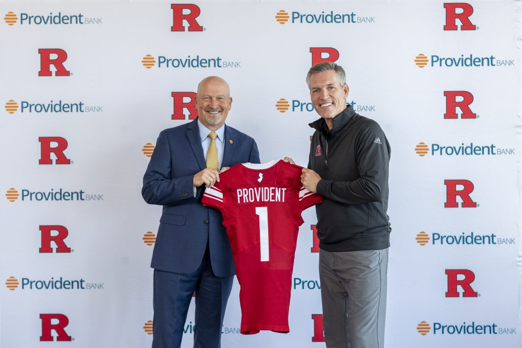 From left, Chris Martin, chairman, president and CEO of Provident Bank is presented a Rutgers football jersey by Patt Hobbs, director of intercollegiate athletics, Rutgers University, to commemorate the partnership between the two organizations.