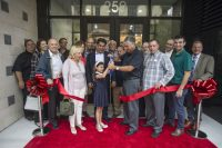 Bayonne Mayor James Davis joins representatives of Skye Development, LLC and other local officials to cut ribbon and officially open Skye Lofts South, a new 90-home rental building in this Hudson County City. - JENNIFER BROWN