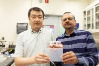 Zhiqian Wang and Somenath Mitra demonstrate 3-D printed battery parts. - NJIT