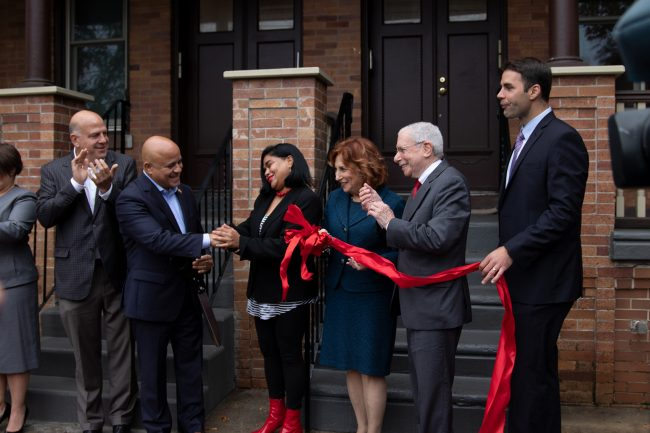 Officials gather at the Cooper Plaza Historic Townhomes in Camden on Oct. 29, 2019 to celebrate its re-opening.