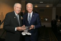 Former Vice President Joe Biden presents William J. Hughes with a Lifetime Achievement Award in 2017 at Stockton's Hughes Center. - STOCKTON UNIVERSITY