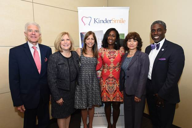 From left, Dr. Frank Mazzarella, chief medical officer, Clara Maass Medical Center; Mary Ellen Clyne, president and chief executive officer, Clara Maass Medical Center; New Jersey First Lady Tammy Snyder Murphy; Nicole McGrath-Barnes, founder and CEO, KinderSmile Foundation; Dr. Annette Cozzarelli-Franklin, director, Women's Health Services, Clara Maass Medical Center; and Darwin Hayes, State of New Jersey Dental Director at the 2019 SMILE! awards at Clara Maass Medical Center. - KSF