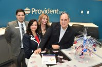 On Nov. 8 and Nov. 9 all Provident Bank branches in New Jersey and Pennsylvania celebrated Military Appreciation Days in honor of veterans and active duty U.S. service members. In addition to offering a CD promotion, the branches served refreshments and handed out flag magnets. From left, Anthony Grzan, banking center manager; Ylka Padilla, vice president, market manager; Josephine Moran, executive vice president, director of retail banking; and Rick McNeil, president, Seventy‑Four Construction.
