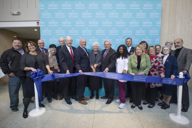 Michael Maron and Robert Menendez join staff and dignitaries at the ribbon cutting ceremony for the Sister Claire Tynan School of Nursing in Englewood Cliffs on Nov. 18, 2019. - JENNIFER BROWN