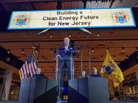 Gov. Phil Murphy announces an initiative to increase the state's offshore wind goal to 7,500 megawatts by 2035 at the Liberty Science Center on Nov. 19, 2019.