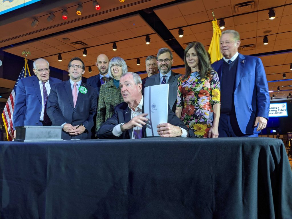 Gov. Phil Murphy is joined by former Vice President Al Gore and First Lady Tammy Murphy to sign an Executive Order to increase the state's offshore wind goal to 7,500 megawatts by 2035 at the Liberty Science Center on Nov. 19, 2019.