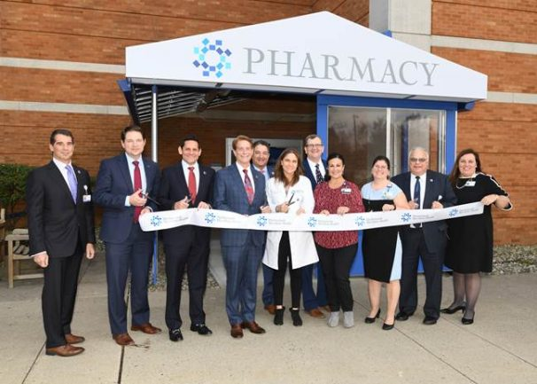 From left, Dr. Massimo Napolitano, Jason Kreitner, Dr. Kenneth Sable, Robert Garrett, Richard Epstein, Audra Manekas, Robert Schenk, Lisa Antonacci, Pam Egnatovich, Dr. Vincent Vivona, and Marie Foley attend the ribbon-cutting ceremony for Ocean Medical Center's expanded pharmacy on Nov. 27, 2019. - HACKENSACK MERIDIAN HEALTH