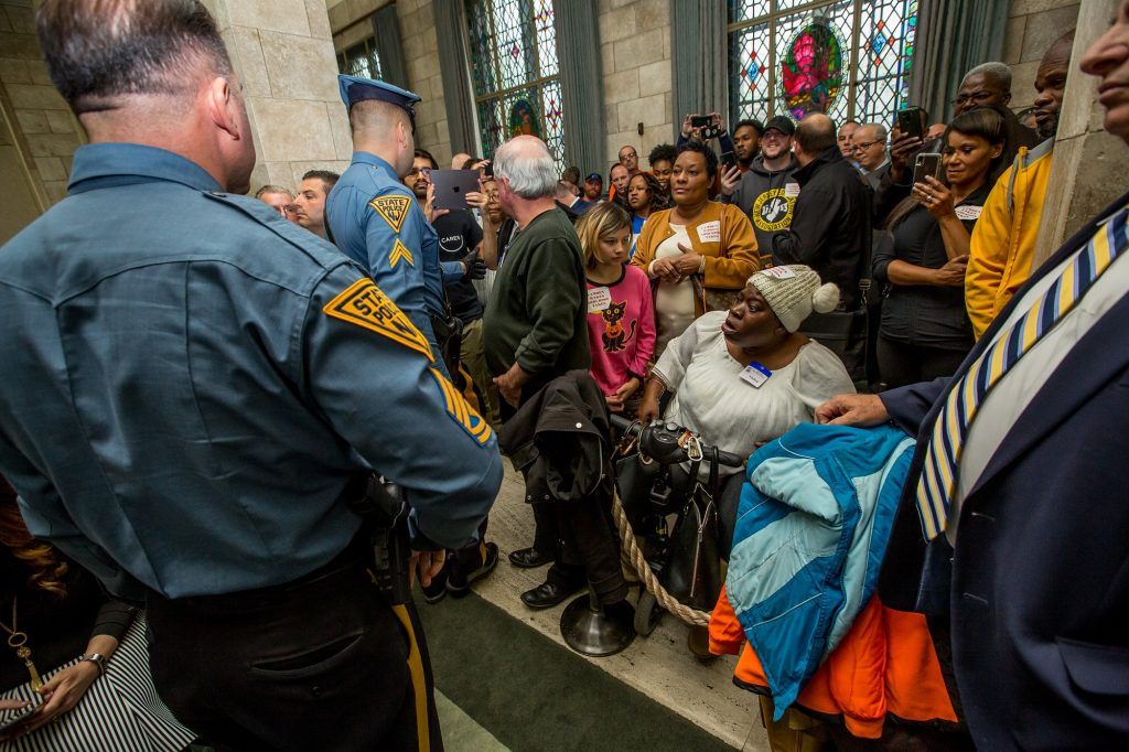 Protesters are asked to leave during the Seneate Select Committee on Economic Growth Strategies in Trenton on Nov. 18, 2019.