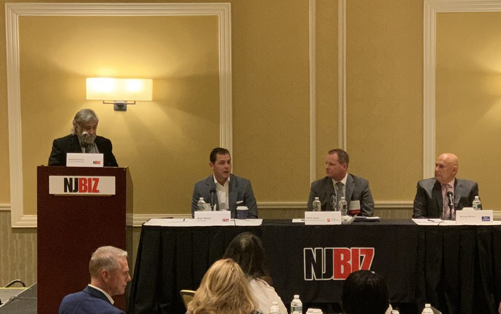 From left, NJBIZ senior health care reporter Anthony Vecchione moderates a health insurance panel discussion featuring FNA Insurance Services Vice President Brian Bodner, Atlantic Health System Vice President of Insurance Networks Kevin Joyce, and AmeriHealth New Jersey market President Michael Munoz on Nov. 19 in Somerset.