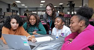 """On Nov. 22, more than 100 Lockheed Martin employees volunteered during the Women in Engineering Day event at the Rotary and Mission System's facility in Moorestown. This year, the annual event brought together 150 female high school students from more than 20 South Jersey and Philadelphia region schools. Here, students participate in an """"hour of coding,"""" during which time they work as a team to solve difficult mathematical problems. - ROBERT O'NEIL"""