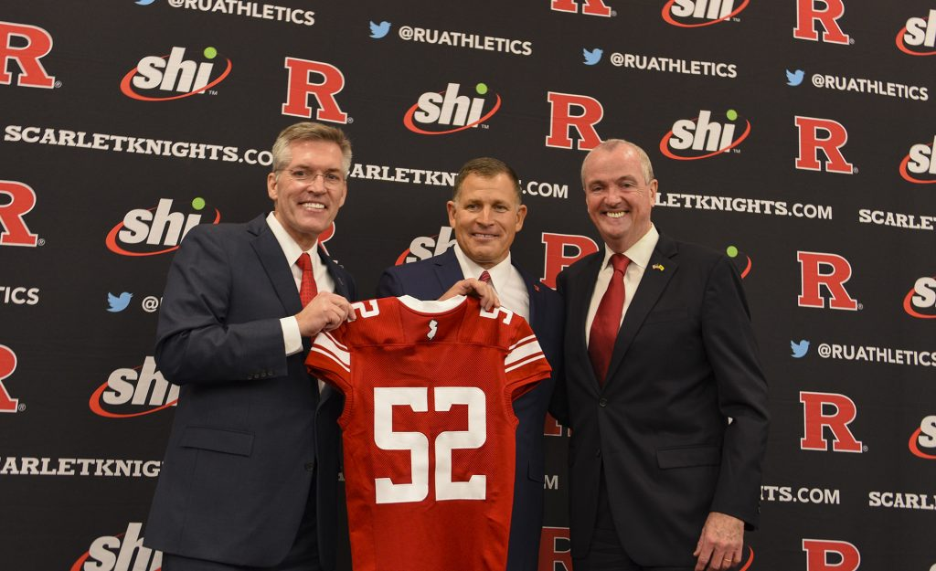 From left, Rutgers Athletic Director Pat Hobbs, Scarlet Knights Football Coach Greg Schiano and Gov. Phil Murphy welcome Schiano back to Rutgers at the Hale Center on the Rutgers Piscataway campus on Dec. 4, 2019.