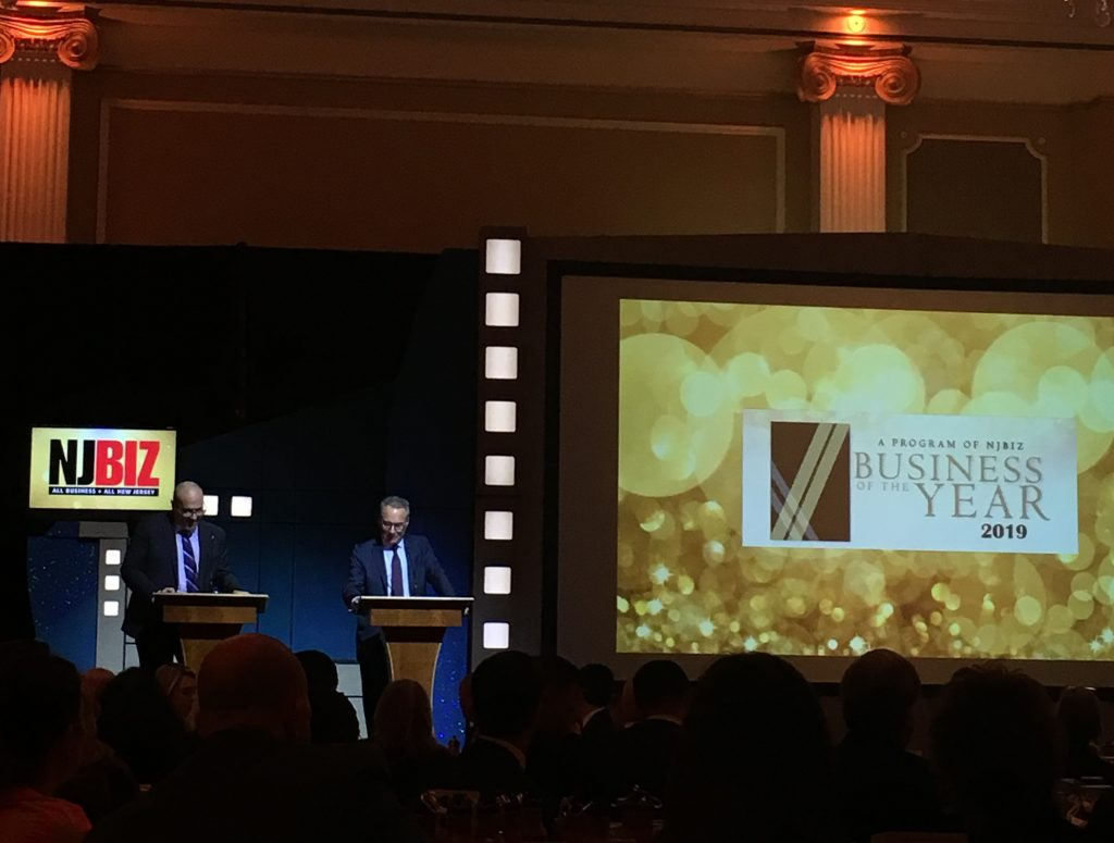 NJBIZ Publisher Ken Kiczales and Editor Jeffrey Kanige present awards during the 2019 Business of the Year Awards on Dec. 10, 2019 at the Palace at Somerset Park.