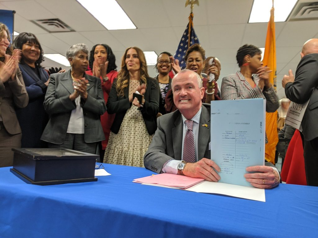 Gov. Phil Murphy signs legislation to expunge certain marijuana offenses from criminal records on Dec. 18, 2019 in Newark.