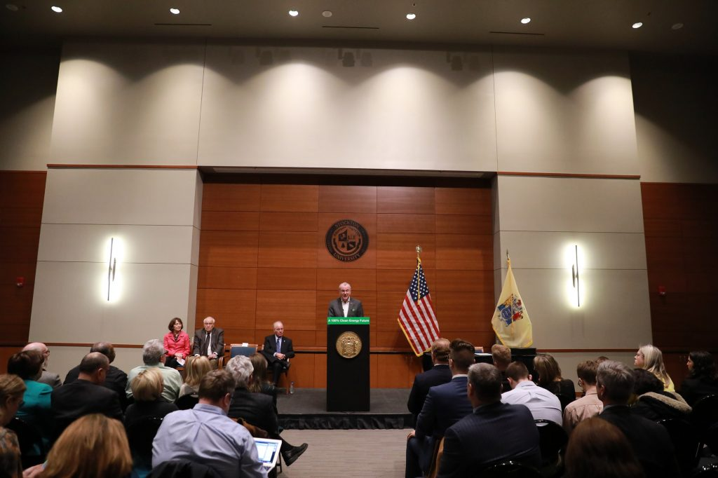 Gov. Phil Murphy unveils New Jersey's Energy Master Plan and signs an executive order directing a new suite of climate regulations at Stockton University on Jan. 27, 2020.