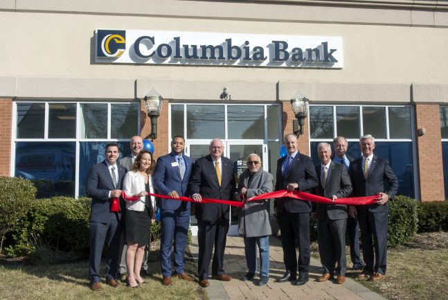 Columbia Bank cuts the ribbon on its newest location in Lyndhurst on Jan. 27, 2020. From left, Matthew Crocco, 1st senior vice president, head of retail banking; Daniel White, regional market manager; Allyson Schlesinger, executive vice president, head of consumer banking; Anttwine Foster, branch manager; and Noel Holland, chairman of the board; Mayor Robert Giangeruso; Thomas Kemly, president and CEO; E. Thomas Allen Jr., senior executive vice president and COO; and Henry Kuiken and Paul Van Ostenbridge, members of Columbia board of directors.