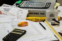 Filing taxes and tax documents.