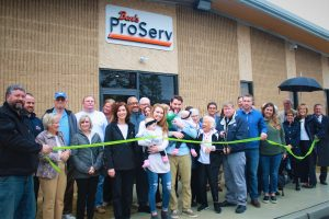 The extended family of Ben's ProServ cut the ribbon on their new headquarters in the Vineland Industrial Park.