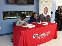 Atlantic Cape Community College President Barbara Gaba and Thomas Edison State University President Merodie Hancock sign an agreement to allow students to complete three years at Atlantic Cape and finish at TESU. - ATLANTIC CAPE COMMUNITY COLLEGE