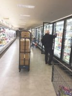 Bob Etzkorn stocks shelves in the dairy aisle. - JOSEPH COLLISON