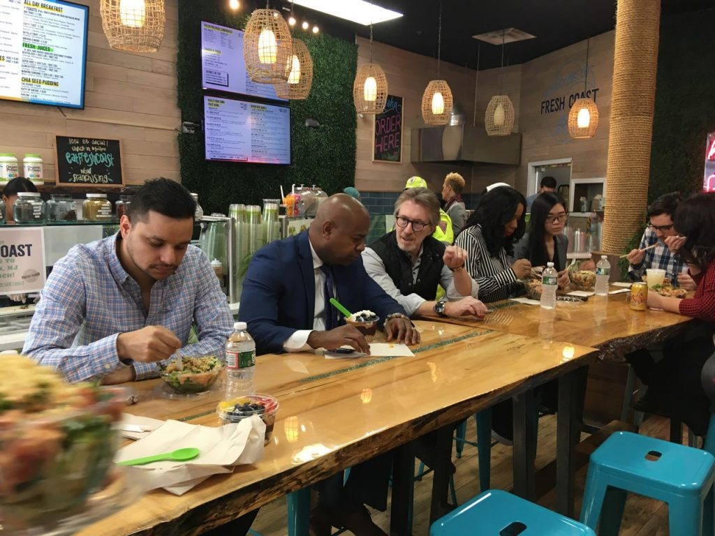 Newark Mayor Ras Baraka and Audible Executive Chairman Don Katz sit together together a celebration of Audible's 30,000th Lunch out Wednesday at Fresh Coast on March 4, 2020.